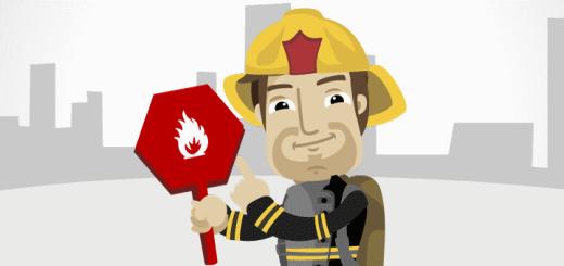 Feuerwehrmann mit Brandklassen Zeichen